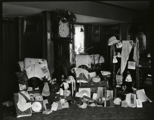"""A photograph taken at William Purcell's grandmother's house, the Catherine Gray House in Minneapolis, likely shows the wedding presents given to William and Edna in December 1908, including a waistcoat and tie for William, and nightgowns, stockings, and embroidered bags and purses for Edna—some of which may have been """"halfways."""" (Photo courtesy William Gray Purcell Papers, Northwest Architectural Archives, University of Minnesota Libraries.)"""