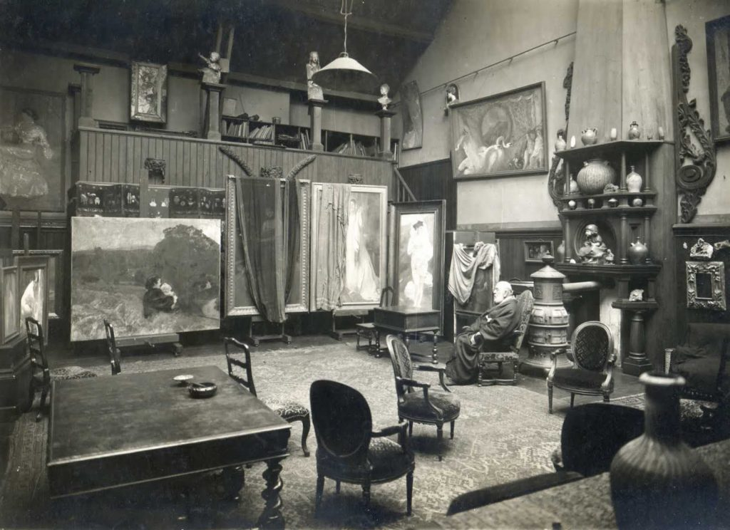 Undated photo of Albert, in his later years, in the Besnards' Paris studio. Note the fireplace designed by Charlotte, which includes a portrait she made of their young daughter Germaine on the mantel.