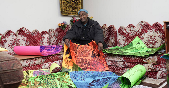 Hassan Nor with his drawings.