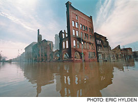 Grand Forks smolders after flooding and fire in 1997. The photograph is by Eric Hylden, who was among the Grand Forks Herald newspaper staffers awarded with Pulitzer Prizes for their coverage of the catastrophe.
