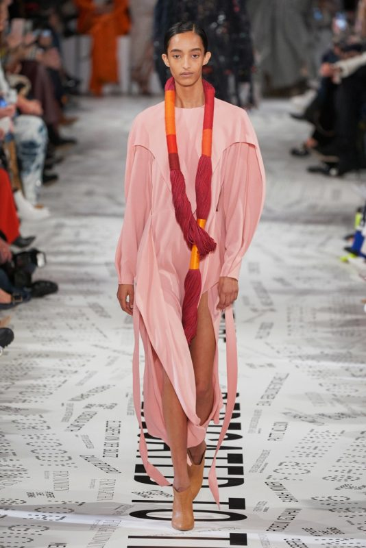 Another model wearing Stella McCartney's ensemble with Sheila Hicks' fiber art at Paris Fashion Week.